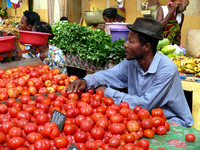 Man selling tomatoes in Nosy Be Market.